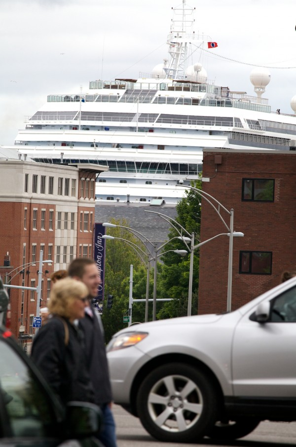 Portland's first cruise ship of the season, the Carnival Glory, towers over the waterfront Tuesday.  It is the first-ever cruise ship to load provisions in Portland in what city officials hope is the start of an ongoing practice.