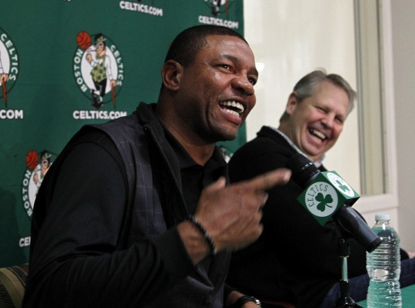 Boston Celtics NBA basketball coach Doc Rivers (left) and Celtics Basketball Operations President Danny Ainge (right) react while taking questions from reporters at the teams practice facility during a news conference, in Waltham, Mass., Thursday, Dec. 1, 2011.