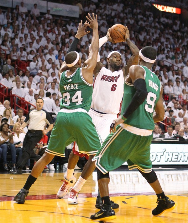 LeBron James looks to pass against Paul Pierce (left) and Rajon Rondo during the third quarter of game 5 of the NBA Eastern Conference Finals between the Boston Celtics against Miami Heat at the AmericanAirlines Arena in Miami on Tuesday, June 5, 2012.
