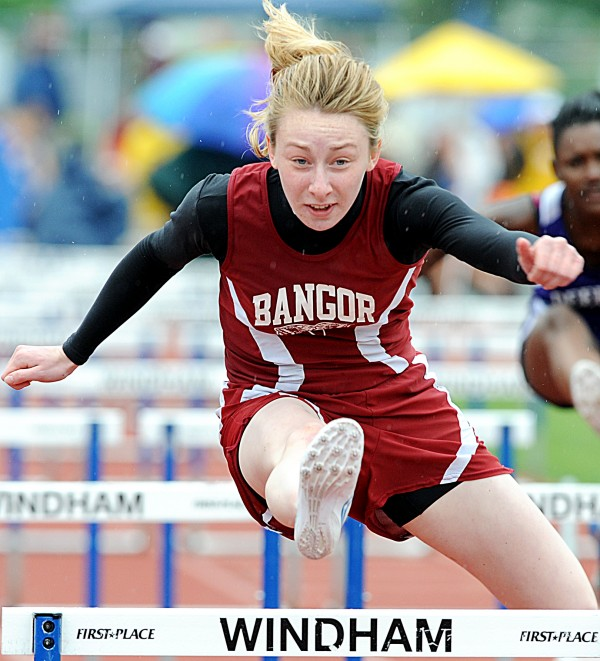 Bangor's Grace Maclean easily clears the 100-meter hurdles Saturday at the Class A State Championship track meet in Windham.