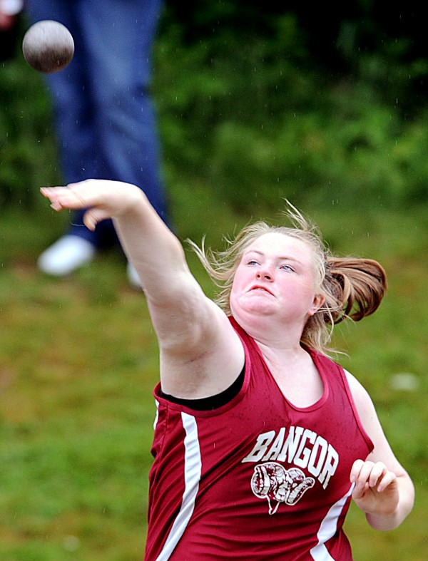 Bangor's Ashley Flint unleashes her shot during the first flight of finals in the Class A State Championship shot put competition Saturday in Windham.