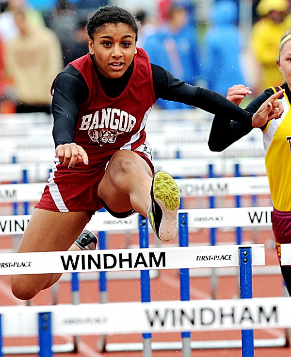 Denae Johnson of Bangor races through the 100-meter hurdles Saturday in Windham.