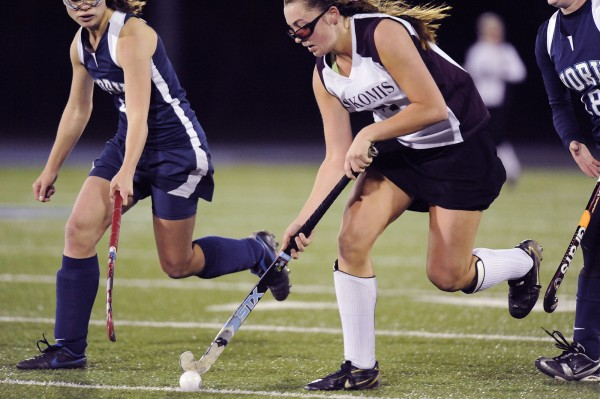Nokomis' Marissa Shaw (17) works the ball down the field under pressure from York High School's Meghan Boria-Meyer (4) and Emily Garry (18) in the second half of their state championship game in Orono, Saturday, Oct. 30, 2010.
