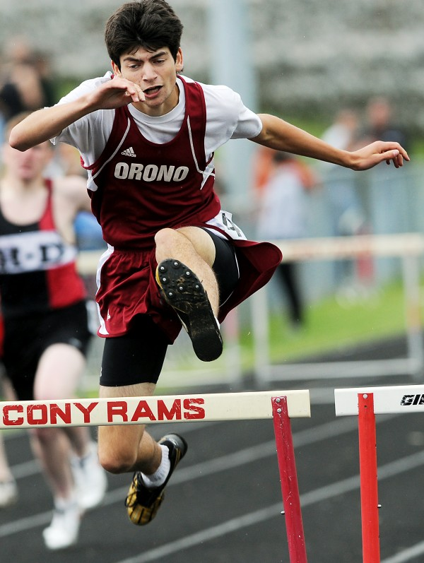 Orono's Brandon Crocker competes in the 300-meter hurdles at the Class C State Championship in Augusta Saturday.