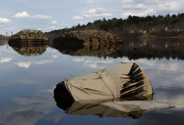 A large roll of partially burned paper came to a rest a few hundred yards downriver from the Maine Central Railroad rail car derailment along the Penobscot River in April 2006.
