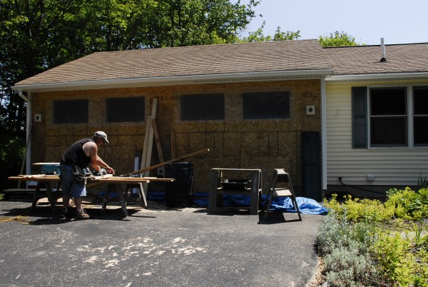 Kevin Brockett, an employee with Long Cove Builders, cuts siding at a home renovation project in Harpswell on June 20, 2012.