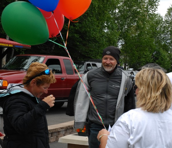 Friends, family and balloons were all on hand to greet Fred Carter and his wife Rhonda Carter (left) when they arrived in Madawaska on Saturday morning, June 23, 2012 after completing their Four Corners Bucket List ride.