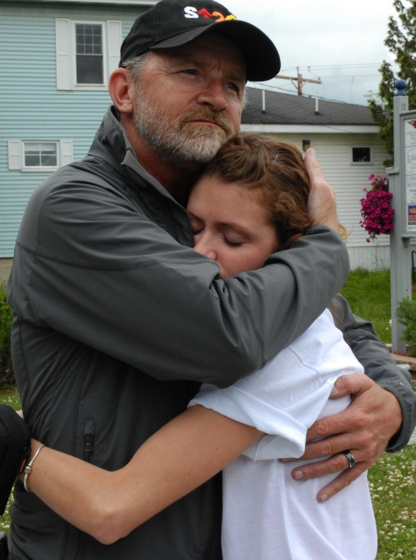 Fred Carter spends a quiet moment with his daughter Katilyn Carter after he and his wife Rhonda arrived in Madawaska on Saturday, June 23, 2012, completing a more than 12,000-mile journey to the four corners of the country. Last fall Fred Carter was diagnosed with stage-four stomach cancer and spent the winter planning his Bucket List Ride in support of cancer awareness and research. &quotI think my dad is incredible,&quot Katilyn Carter said. &quotI am just so happy they got to do this.&quot