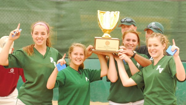 Resse Leonard (10), Kirstin Batchelder (1), Eliza Pelletier (24) and Kayla Dube (12) of Penobscot Valley High School hold the trophy after defeating Richmond High School for the Class D State Championship at Coffin Field in Brewer on Saturday, June 16, 2012.