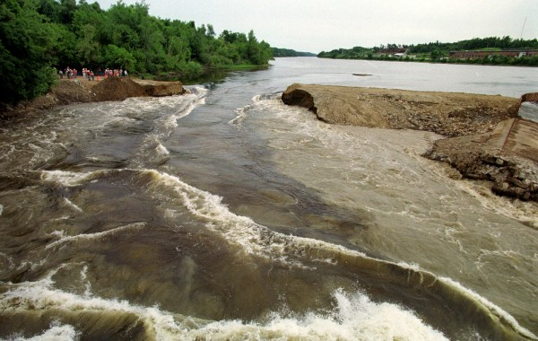 In this July 1, 1999, file photo, a torrent of water pours through an opening in the 162-year-old Edwards Dam on the Kennebec River, in Augusta, Maine.