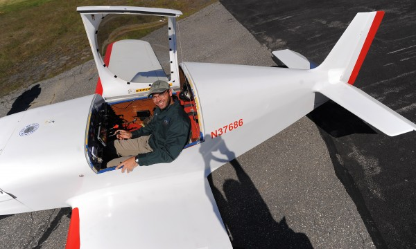 Dave Robins, 29, sits in his Experimental KR-2 aircraft at the Old Town Municipal Airport Tuesday. Robins flew the small airoplane from Mojave, Calif., starting on June 6 and dodging storms. He made it to Maine on Sunday. His goal is to fly around the country during his five-week-long vacation in the tiny aircraft, which can cover about 800 miles a day.