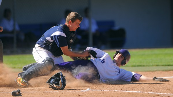 Bangor Christian High School's catcher Rem Poulin (left) tags Couthern Aroostook Community School's Joseph Frazier as he was sliding to home plate during the fourth inning of the Eastern Maine Class D final game in Bangor Thursday.