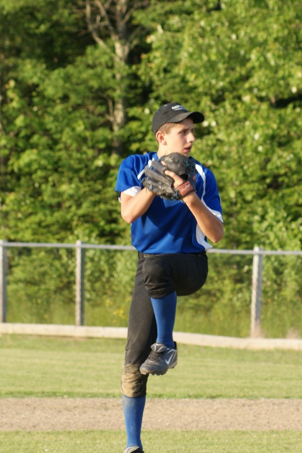 Liberty Little League pitcher Emmett Shell delivers a pitch during a game Thursday night. Shell recorded a perfect game last Saturday.