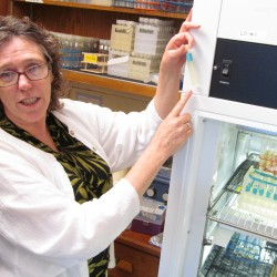 """University of Southern Maine biology Prof. Lisa Moore holds a culture of prochlorococcus, the most abundant photosynthetic bacteria in the world's oceans, at her Portland lab Thursday, June 14, 2012. Moore is taking part in a $13 million National Science Foundation project to develop an evolutionary """"Tree of Life."""""""