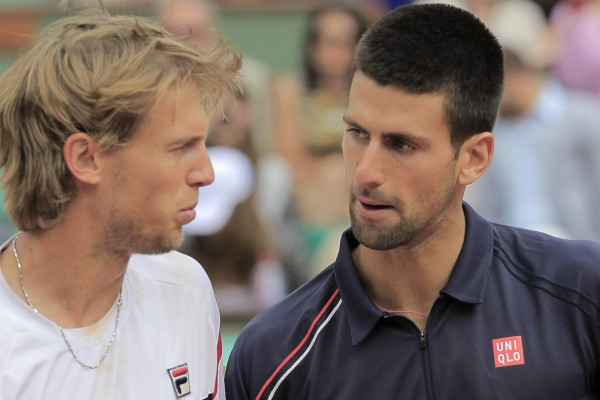 Novak Djokovic of Serbia (right) talks to Andreas Seppi of Italy after winning his fourth-round match at the French Open tennis tournament in Roland Garros stadium in Paris, Sunday June 3, 2012. Djokovic won in five sets 4-6, 6-7, 6-3, 7-5, 6-3.