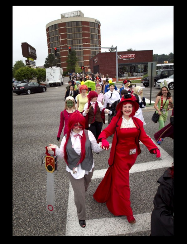 Abigayle Johnson (left), dressed as Grell, and Lea Nolette as Madam Red, from the Japanese anime series &quotBlack Butler,&quot walk in a parade from the Doubletree Hotel to the Maine Mall last Saturday in South Portland, where more than 100 PortConMaine convention-goers participated in a fashion show.