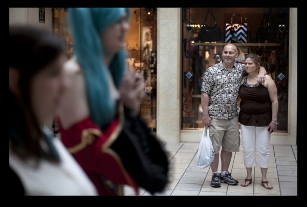 Dennis and Carol Ranger of Gorham watch a parade of geeks march through the Maine Mall last Saturday in South Portland. More than 100 people from the PortConMaine anime and gaming convention participated in a fashion show at the mall.