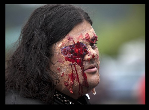 Angel Abreu of Biddeford, made up to play the part of a pet zombie, takes part in the parade of science-fiction fans at last Saturday's PortConMaine convention in South Portland.
