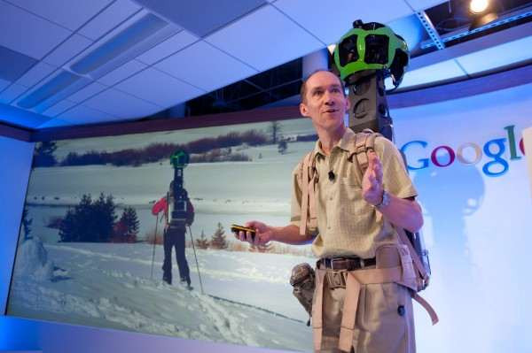 In this photo provided courtesy of Google, Luc Vincent, Google Engineering Director, demonstrates how Google captures images in hard to reach places with Street View Trekker at the Google offices in San Francisco, Wednesday June 6, 2012.