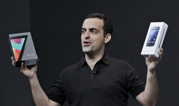 Hugo Barra, Director of Google Product Management, holds up a box of the Google Nexus 7 tablet, left, and the Galaxy Nexus phone, right, at the Google I/O conference in San Francisco, Wednesday.