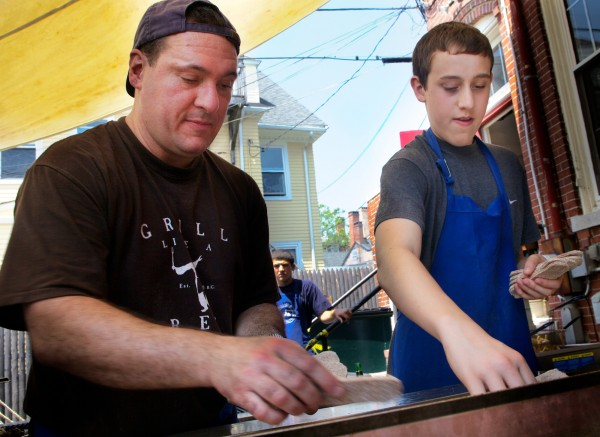Tim Morrell, along with his 16-year-old son Matt, put more gyro on the grill at the annual Greek Food Festival put on by Holy Trinity Greek Orthodox Church on Pleasant Street in Portland on Friday, June 29, 2012.