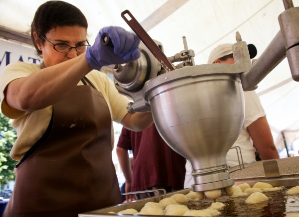 Andrea Nutter of Westbrook cranks out deep-fried loukoumades at the annual Greek Food Festival put on by Holy Trinity Greek Orthodox Church on Pleasant Street in Portland on Friday, June 29, 2012.