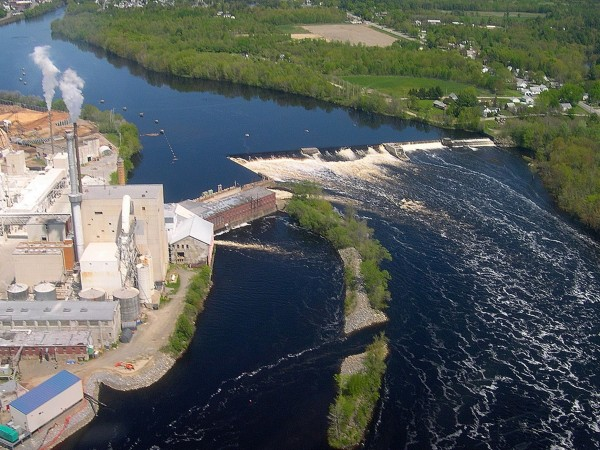 The soon-to-be-removed Great Works Dam on the Penobscot River in Old Town is adjacent to the Old Town Fuel and Fiber facility, seen on left. Photographed late May 2012.