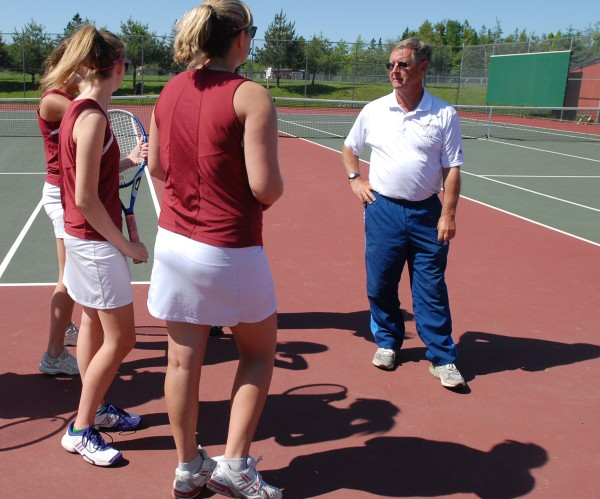 Ellsworth tennis coach Brian Higgins talks with his team before its match against Hermon on June 1, 2012. Higgins celebrated his 600th victory Friday afternoon.