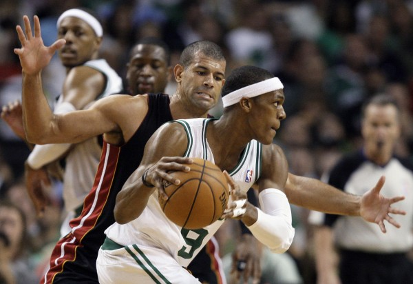 Boston Celtics guard Rajon Rondo (9) drives against Miami Heat forward Shane Battier during the third quarter of Game 3 in the NBA playoffs Eastern Conference finals, in Boston on Friday, June 1, 2012.