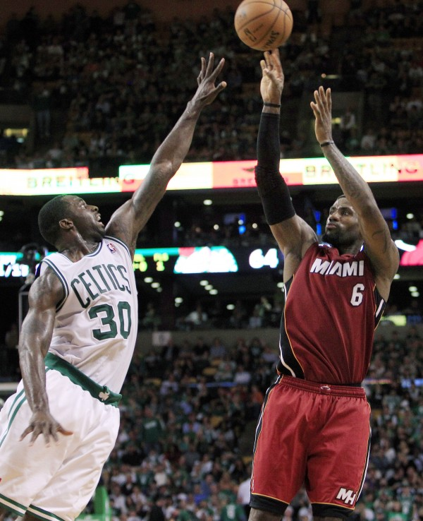 Miami Heat forward LeBron James (6) shoots against Boston Celtics forward Brandon Bass (30) during the fourth quarter in Game 6 of the NBA Eastern Conference finals against the Boston Celtics, Thursday, June 7, 2012, in Boston. Miami won 98-79.
