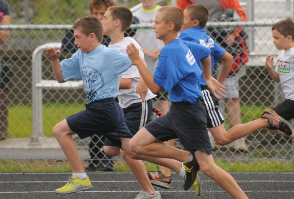 Connor Demerchant of Presque Isle (far left) leads in the 9-10-year-old boys 50 meter dash during the Hershey Track & Field Regional Meet in Brewer Tuesday.  Demerchant won the heat with the time of 8.50 seconds.