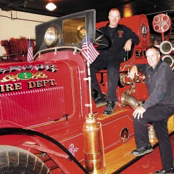 Lt. John Gray (seated) and Capt. Matthew Costello on a 1930 McCann 1000 pumper, fully restored and running great.