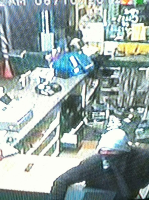 A surveillance camera image shows the man who broke into the Squire convenience store in Holden early Sunday morning.