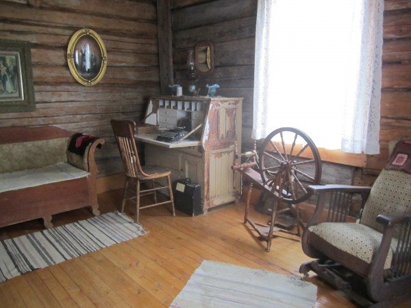A room in the historic, restored &quotLindsten Stuga&quot at New Sweden's 2012 Midsummer Festival.