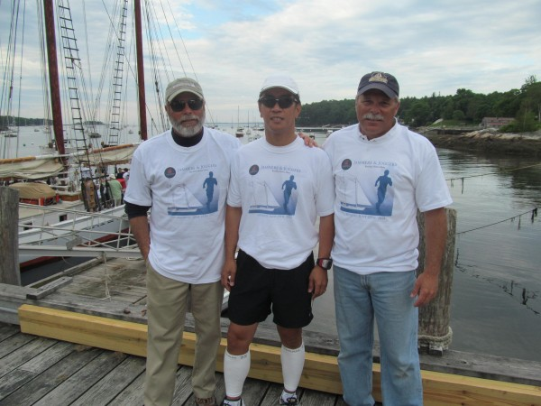 Dr. Aquilino Alamo of the Boothbay Harbor (center) area poses with Captains of the Schooner Timberwinds, Bob (left) and Joe Tassi, early Monday, June 25, 2012, before the start of the &quotJammers and Joggers&quot race.