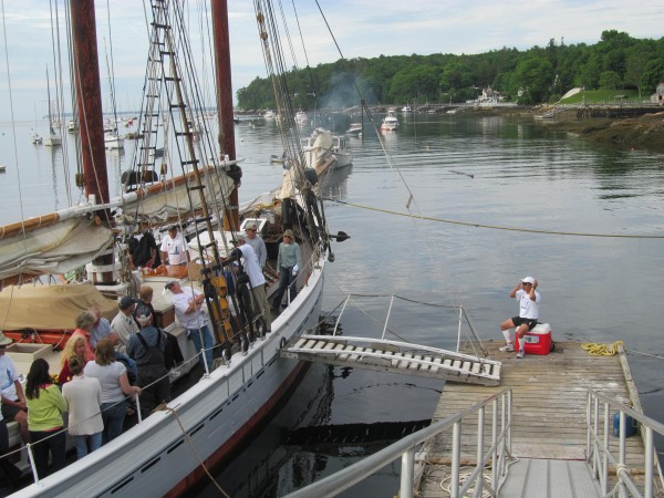 Dr. Aquilino Alamo of Boothbay Harbor sits down for the last time Monday, June 25, 2012, before embarking on a more than 45-mile race from Rockport to Boothbay Harbor against the Schooner Timberwinds, shown at left.