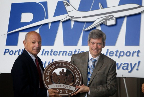 Portland Mayor Michael Brennan and Portland International Jetport Director Paul Bradbury cradle the airport's new LEED Gold certification from the U.S. Green Building Council Wednesday morning June 27, 2012.