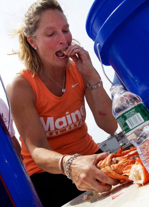 Lisa Bailey-Carroll chows down on as many lobster as she can in 10 minutes during a crustacean-eating contest in Portland Saturday, June 30, 2012.