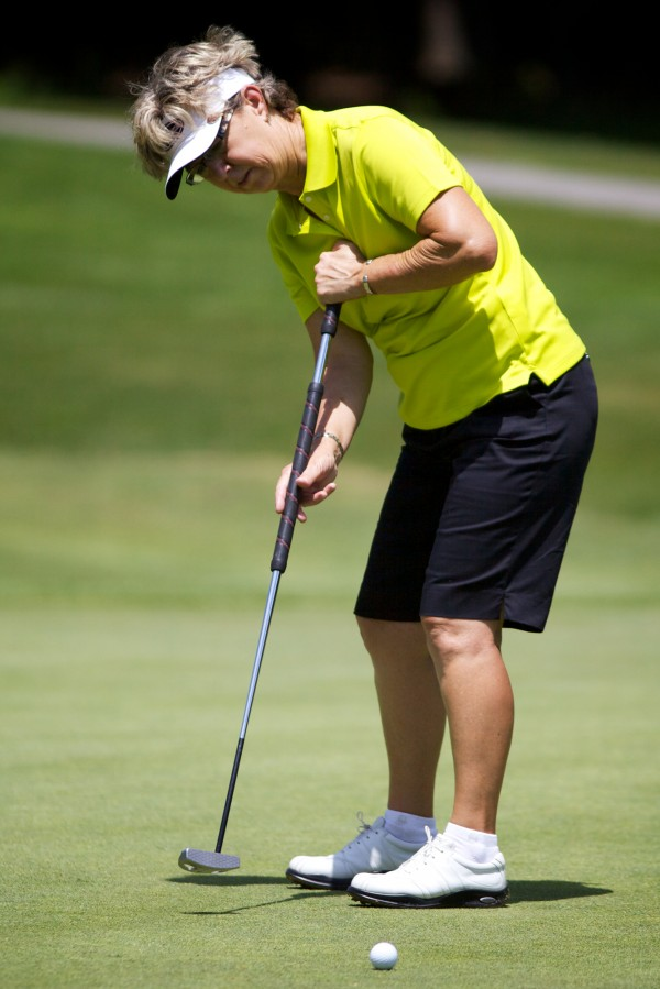 LPGA Legends Tour golfer Sherri Turner makes a put at the Hannaford Community Challenge Tournament in Falmouth Sunday June 24, 2012. Turner won, coming in six under par.