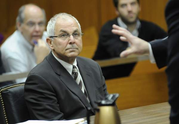 In this April 3, 2009 file photo, Peter Madoff, brother of Bernard Madoff, attends his court hearing before judge Stephen Bucaria at Mineola State Supreme Court, in Mineola, N.Y.  The younger brother of a man who became an icon for financial crime after the economy collapsed in 2008 is poised to plead guilty to criminal charges, taking his place in history alongside Bernard Madoff, the sibling he shared an office with for decades. The plea by 66-year-old Peter Madoff is scheduled for Friday, June 29, 2012 inside U.S. District Court. (AP Photo/Louis Lanzano, Pool, File)