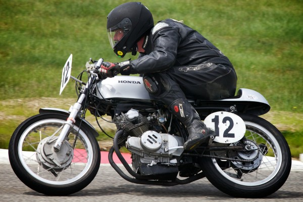 Freeport book designer and printer Scott Vile, 52, makes a turn at the New Hampshire Motor Speedway Monday, June 11, 2012, while racing his vintage 175cc Honda motorbike. Vile finished in 3rd place.