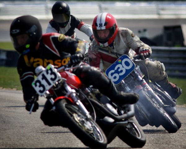 Steve Baker, a carpenter from Freeport, speeds around a corner between two other riders at the United States Classic Racing Association Grand Prix in New Hampshire Monday, June 11, 2012. Baker finished 5th.