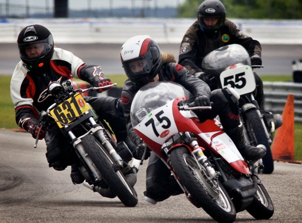 Kerry Smith, 31, of Portland leads a group of racers through one of 12 turns on the 1.6-mile road course at the New Hampshire Speedway during the United States Classic Racing Association Vintage Grand Prix Monday, June 11, 2012.