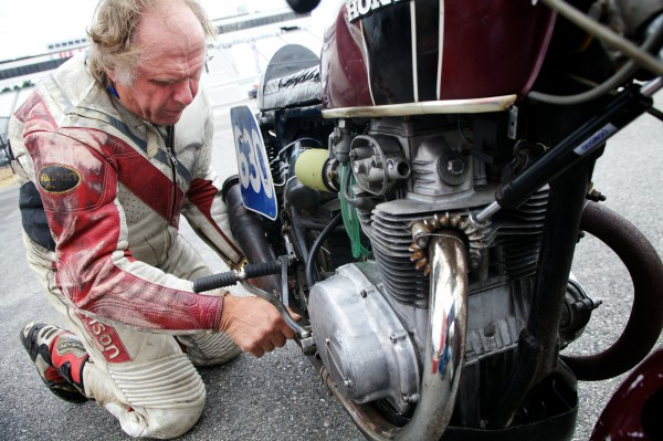 Steve Baker, 60, of Freeport checks his brakes before a race Monday, June 11, 2012, at the United States Classic Racing Association Grand Prix at the New Hampshire Speedway. Baker races a nearly original 1972 Honda CB350 running on regular unleaded gas. Other competitors employ almost completely redesigned vintage bikes running racing fuel.