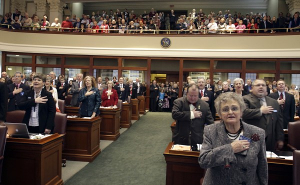 Members of the 125th Maine legislature take the Pledge of Allegiance before being sworn into office in the House chamber on Wednesday, Dec. 1, 2010.