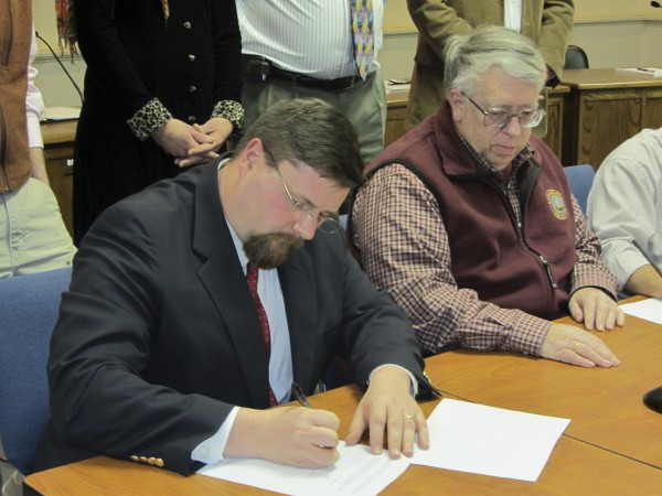 James Smith (left), Rockland's city manager, and Mayor Brian Harden (right) are shown with other Rockland councilors in March.