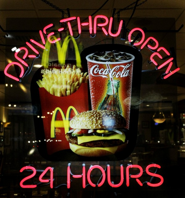 In this file photo taken April 20, 2009, a neon sign reminds patrons at a McDonald's restaurant of the 24-hour service in the Wrigleyville neighborhood of Chicago.