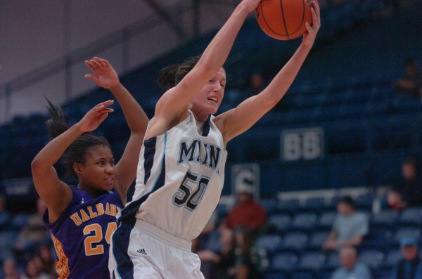 The University of Maine's Samantha Baranowski (50) grabs a rebound with pressure from the University at Albany's Adrienne Jones (24) during a game in January in Orono. Baranowski has signed a contract to play professional basketball in Germany.