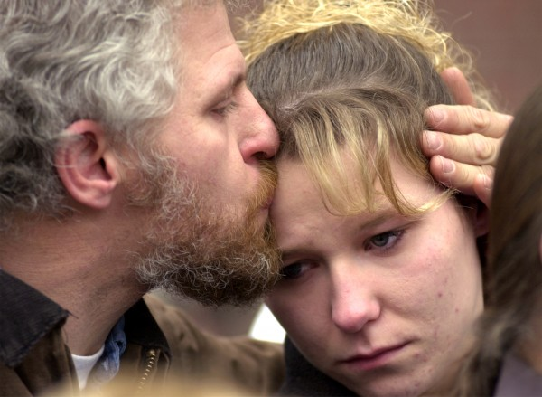 Cassie Cunningham, mother of Treven Cunningham, is comforted by her father, Brent Cunningham Sr., in December 2001 after a jury found Jeffrey Cookson guilty of the 1999 murders of 21-month-old Treven and his baby sitter Mindy Gould.