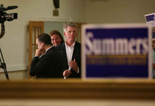 Republican senate candidate and Secretary of State Charlie Summers (right), joined by wife Ruth, watches election results as he waits to be interviewed Tuesday, June 12, 2012 in South Portland, Maine.